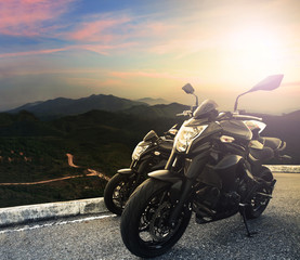 big bike ,motorcycle parking on top of mountain with sun light o