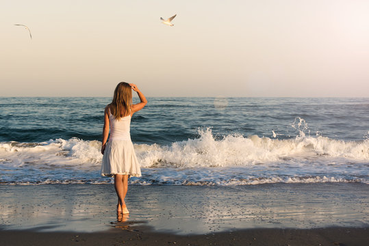 Girl standing at the beach