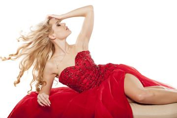 young woman lying down in an elegant dress