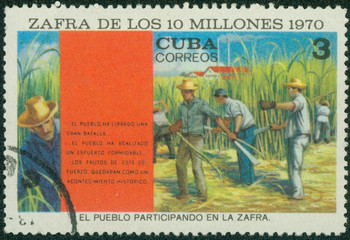 stamp shows the people participating in the harvest