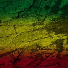 Red, yellow, green rasta flag on stone wall