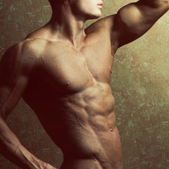 Bodybuilding and body sculpture concept. Handsome man posing