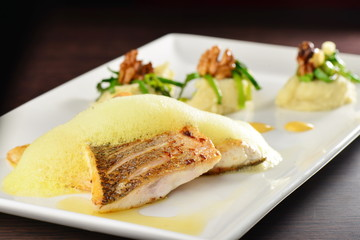 Tasty healthy fish fillet with potato and vegetables