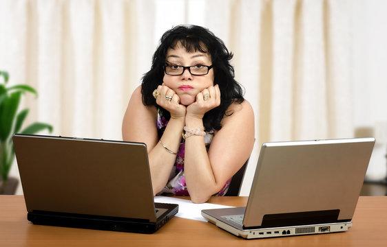 Glasses woman is boring on webinar