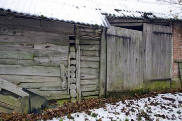ancient farm barn wall with wooden door