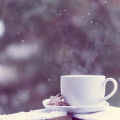 Cup of hot tea and cookies outside