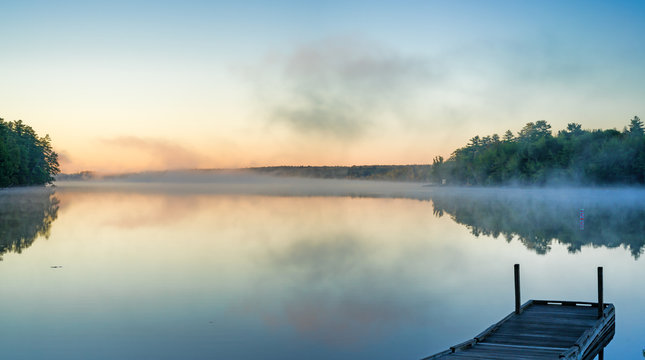 Toddy Pond, Maine with mist and wharf