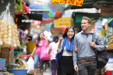 Tourists shopping in street market in Hong Kong