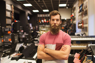 Poster Music store assistant or customer with beard at music store