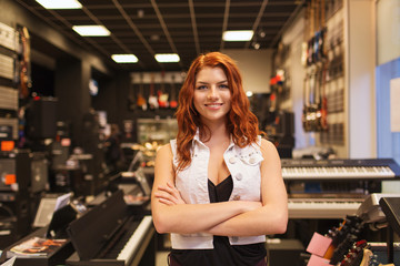 Foto op Plexiglas Muziekwinkel smiling assistant or customer at music store