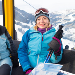 Female skier in gondola.