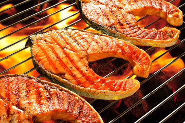 Wall Mural - Grilled salmon on the flaming grill.