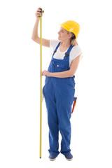 career concept - woman in blue builder uniform holding measure t