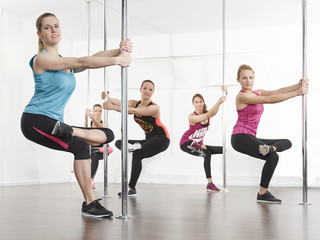Girls group stretch for poledance