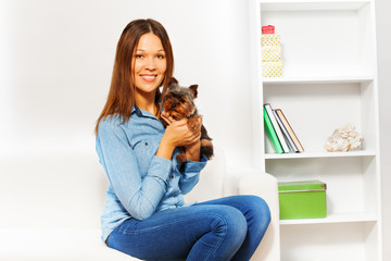 Yorkshire Terrier with smiling woman holding him