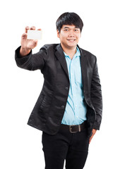 young businss man standing with happy face holding name card in