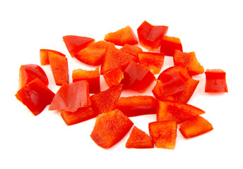Chopped red pepper on white background.