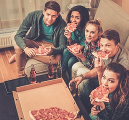 Group of multi-ethnic friends with pizza