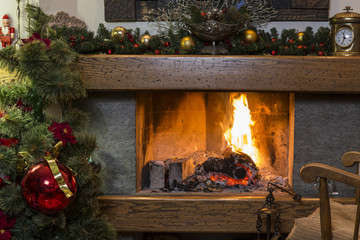 Burning fireplace with christmas decorations