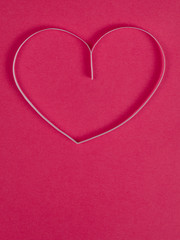 paper heart on pink paper background