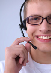Customer support operator with a headset isolated on white