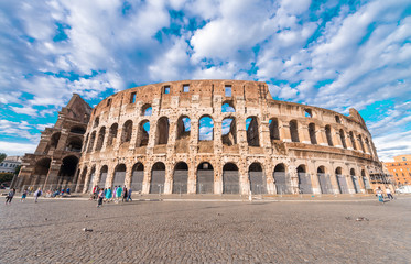 Poster de jardin Rome Stunning view of Colosseum in Rome against blue sky