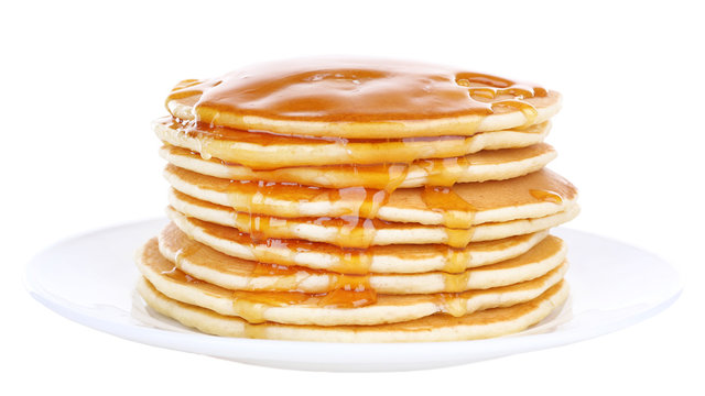 Stack of delicious pancakes with honey