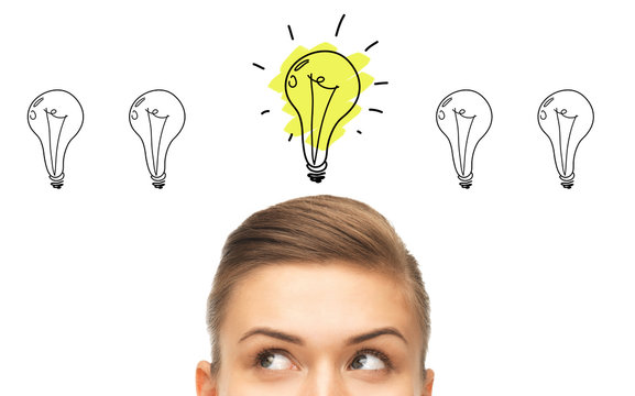 close up of woman looking to lighting bulbs