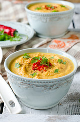 Carrot cream soup with red chili pepper