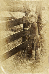 cute little girl playing in the garden. filtered image, old styl