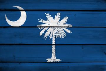 South Carolina State Flag on wood background