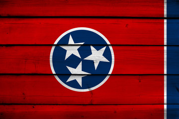 Tennessee State Flag on wood background