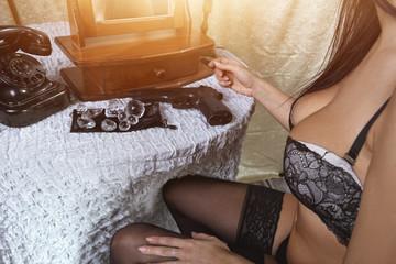 Sexy girl in bra widt gun and diamonds