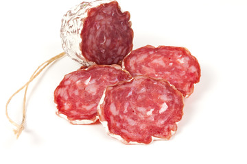 pile of red salami, on a white