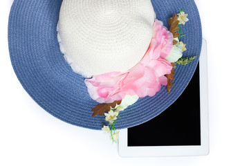 Hats and iPad ready for summer. on white background