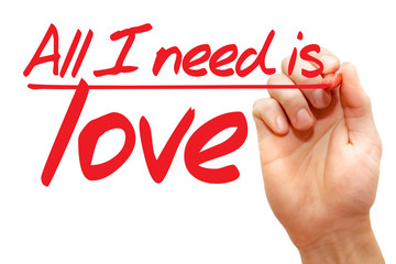 Hand writing All I need is love with red marker