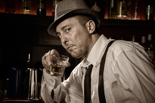 Vintage portrait of a man drinking at a bar