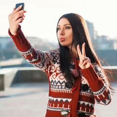 Beautiful woman doing Selfie on phone