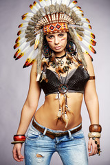 Girl wearing Native American Indian headdress and jewelry