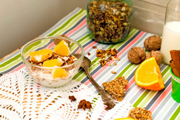 bowl of homemade granola and oranges for breakfast
