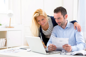 Attractive couple doing administrative paperwork