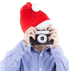 kid with christmas hat shooting with a retro style camera