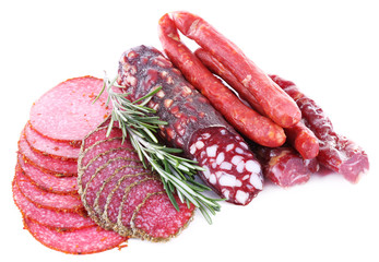 Fototapete - Assortment of smoked sausages isolated on white