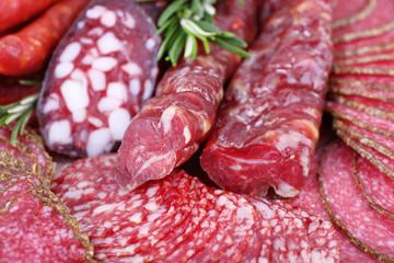 Fototapete - Sliced smoked sausages, macro view