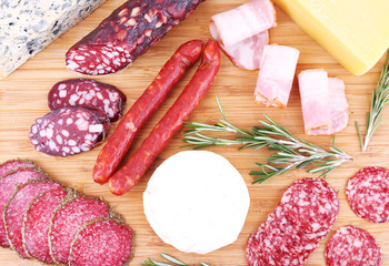 Fototapete - Assortment of smoked sausages and cheese