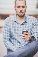 handsome hipster casual multitasking modern man listening music