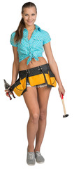 Pretty girl in tool belt holding scissors for metal cutting and