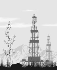 Oil rigs over mountain range.