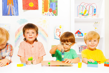 Group of boys in classroom with toy work tools