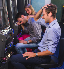 Group of Friend Playing with Slot Machines
